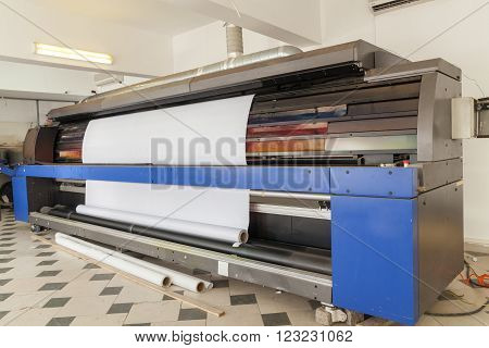 big professional printing machine in printing house