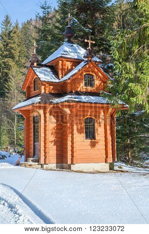 wooden house on the edge of the forest in the wintertime