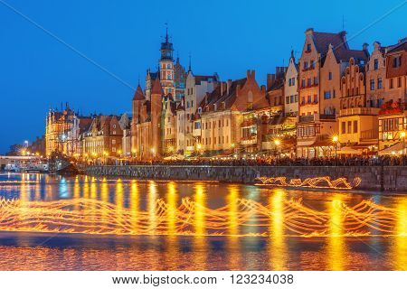 Fire show on Motlawa River during Fair St. Dominic in Gdansk at night, Poland