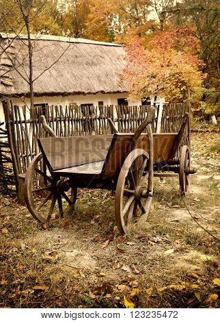 Vintage Wooden Cart In The Yard In The Autumn