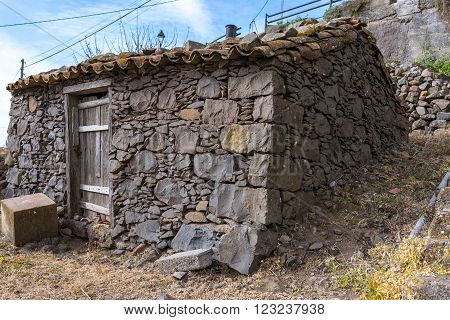 Old stone shed in the terraced gardens of El Cercado, a small village with a beautiful terrace landscape in the highlands of La Gomera. El Cercado is also well known as pottery town on the Canaries