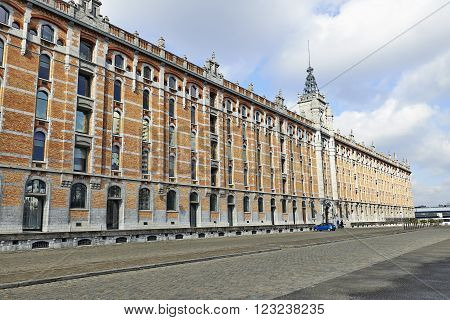 BRUSSELS, BELGIUM - FEBRUARY 22, 2015: Tour et Taxis, Thurn en Taxis  is a large formerly industrial site, example of the quality of 19th century architecture in Brussels, Belgium.