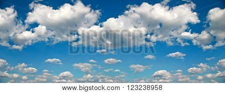 Panorama Of White Clouds Against A Blue Sky
