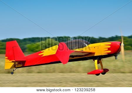 sports model aircraft takes off from airfield