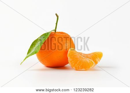 washed tangerine with separated segments on white background