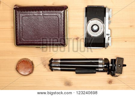 old photo equipment on a wooden board