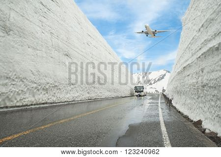 Airplane flying over Tateyama Kurobe Alpine Route, Toyama Prefecture, Japan