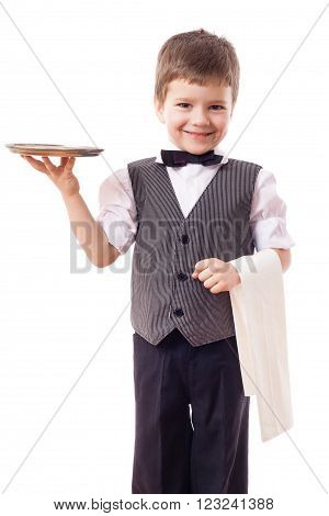 Little kid waiter standing with tray and towel, isolated on white
