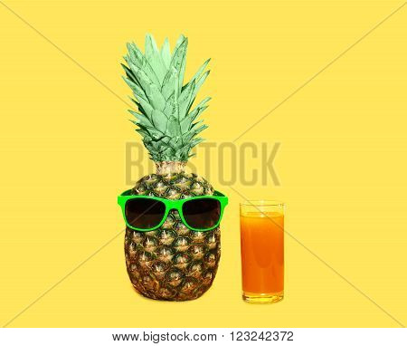 Pineapple With Sunglasses And Glass Fruit Juice On Yellow Background, Colorful Ananas