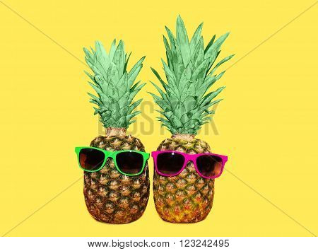 Two Pineapple With Sunglasses On Yellow Background, Colorful Ananas Photo