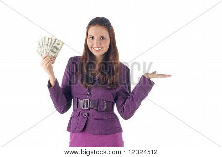 Presenting things. Smiling businesswoman holding dollars