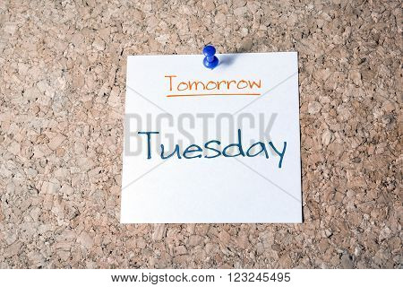 Tuesday Reminder For Tomorrow On Paper Pinned On Cork Board