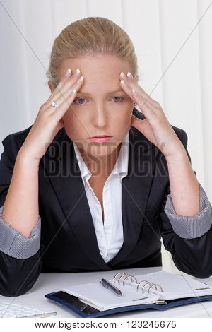 woman with migraine in office