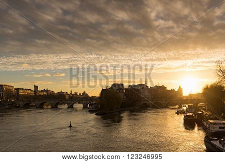 Winter sunrise on the Ile de La Cite, Pont Neuf and the Seine River in the 1st Arrondissement of Paris, France
