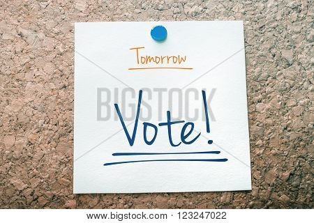 Vote Reminder For Tomorrow On Paper Pinned On Cork Board