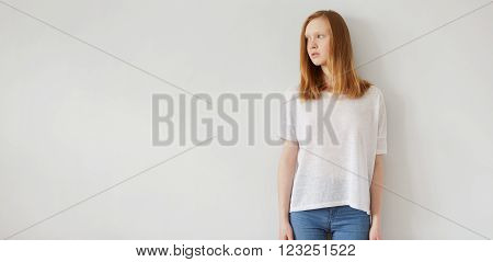 Woman Wearing White Blank T-shirt  Standing On The Background Of A Wall