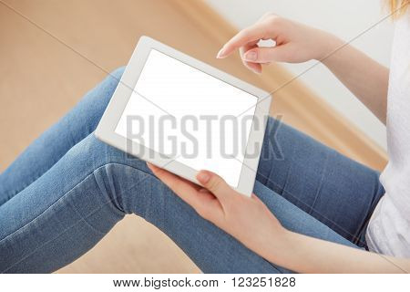 Young Female Student Sitting In A University Recreation Hall Using Touch Pad, Freelancer Girl Workin