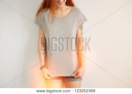 Young Girl Wearing Grey Blank T-shirt And Blue Jeans Shorts. Concrete White Wall Background, Flare L