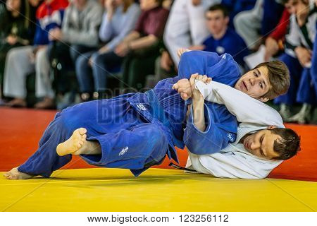 Chelyabinsk, Russia -  March 19, 2016: two fighters fight wrestlers during Russian competition on judo