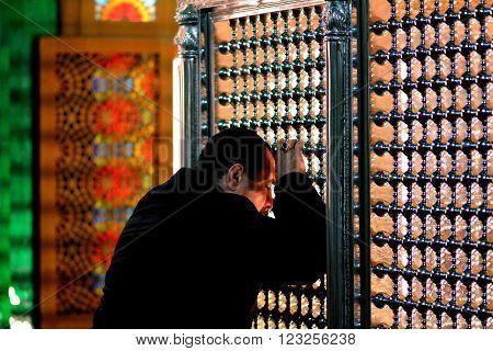 BAKU, AZERBAIJAN - JANUARY 27 2014  The tomb of Ukeyma Khanum in Bibi-heybat Mosque. Worshipper in the most significant mosque in Azerbaijan, just outside the capital, Baku