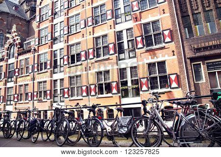 AMSTERDAM; THE NETHERLANDS - AUGUST 19; 2015: View on Oudezijds Kolk canal in Amsterdam, building Verf en Vernis Fabriek H.Vettewinke in Amsterdam. Amsterdam is capital of the Netherlands on August 19; 2015.