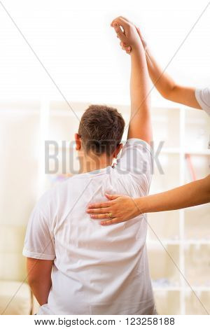 Chiropractor doing adjustment on male patient at a doctor's  office