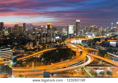 Aerial view interchanged road with city downtown background night view