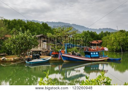 THAILAND, KO CHANG- DEC 14 : Thailand tropical island of Koh Chang. Fisherman's cottage in the mangrove trees on December 14, 2011 in Ko Chang, Thailand.