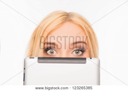 Close Up Portrait Of Young Pretty Woman Hiding Her Face Behind Tablet