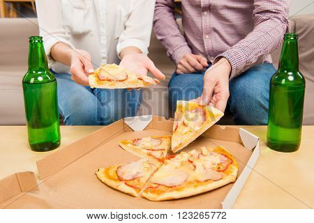 Close Up Photo Of Man And Woman Taking Pizza From Box
