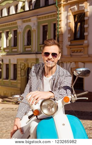 Cheerful Young Man In Spectacles With Moped And Cup Of Coffee