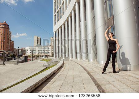 Beautiful Young Slim Graceful Ballerina Dancing Near The Building