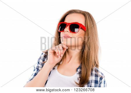 Portrait Of Pretty Minded Woman In Red Glasses Touching Chin