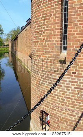 Haarzuilens, Netherlands - May 6: There's moat around park and castle de Haar near Utrecht May 6, 2015 in Haarzuilens, Netherlands.