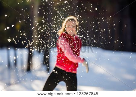 Blurred image the girl throws a snowball