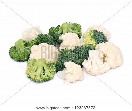 Fresh organic cauliflower and broccoli separated on white background