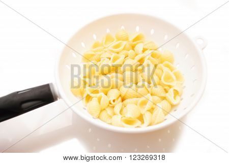 Cooked Shell Pasta Draining in a Strainer