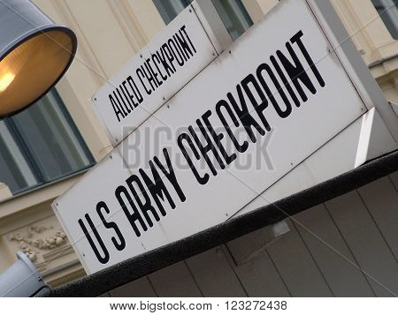 Checkpoint Charlie sign. Checkpoint Charlie was between east and west sectors during the Cold War. Berlin