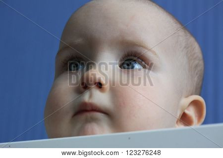 Portrait of a 11-months baby with eyes looking up