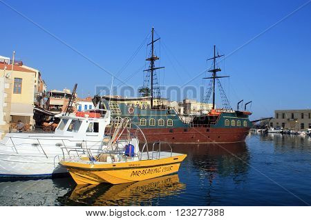 RETHYMNO, CRETE, GREECE - JULY 24, 2015: The boats in old venetian harbor in Rethymno city Crete island, Greece.