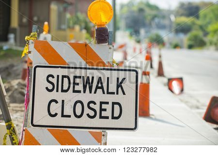 Road street construction zone warning hazard sign sidewalk close