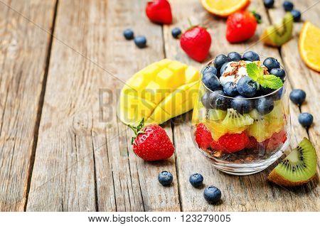 rainbow fruit granola and Greek yogurt parfait ** Note: Shallow depth of field