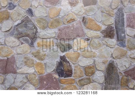 Stone coating of a wall as a textured background