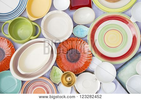 Colorful dishes and utensils on a white cloth