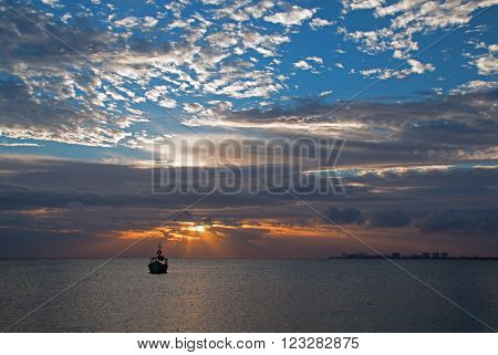 Sunrise View of Mexican Fishing Boat in Cancun's Puerto Juarez harbor