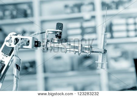 Medical syringe in roboter hand