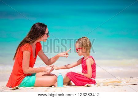 Young mother applying sun cream on her kid ** Note: Soft Focus at 100%, best at smaller sizes