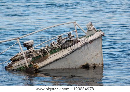 Rusty ship wreck in a blue river
