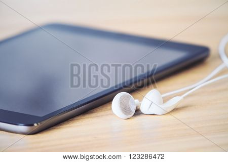 Tablet And Headphones Closeup