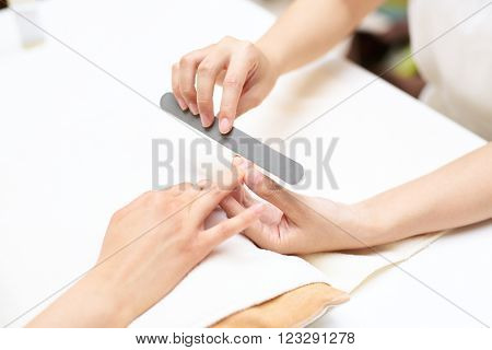 Close up of a woman in a nail salon receiving manicure